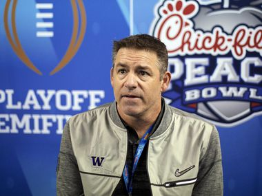 In this Dec. 29, 2016, file photo, then Washington defensive coordinator Pete Kwiatkowski answers a question during media day for the Peach Bowl NCAA college football game against Alabama in Atlanta.