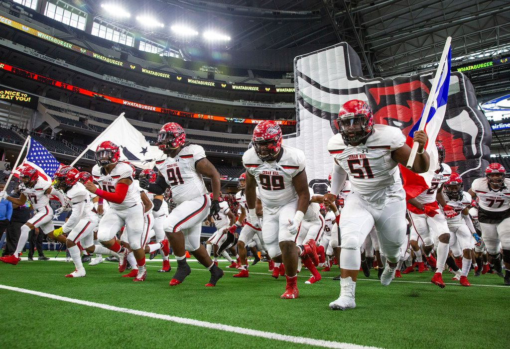 The Cedar Hill varsity team rushes onto the field before the Class 6A Division II area-round high school football playoff game at the AT&T Stadium in Arlington, Texas, on Saturday, November 23, 2019. (Lynda M. Gonzalez/The Dallas Morning News)