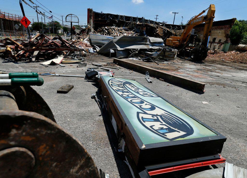 Demolition crews are razing the old El Corazon Mexican restaurant in the Bishop Arts area of Dallas on Monday.