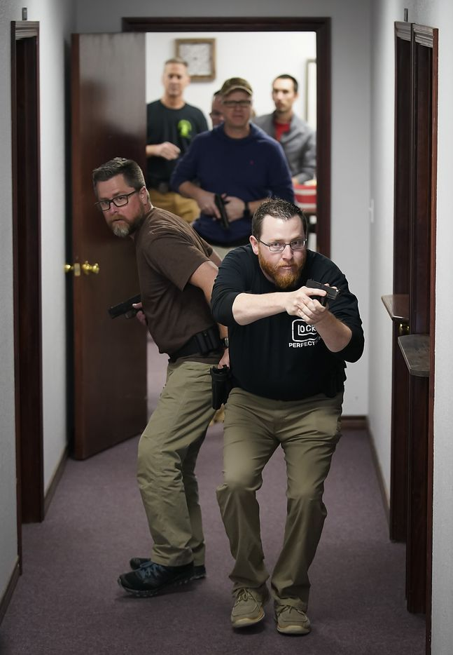 Jared Trainer (right), from Eagles View Church in Fort Worth, and Todd Davidson (left), of Fellowship of the Parks Church in Justin, TX practice searching and clearing a hallway during a Sheepdog Defense Group armed security programs church safety training session at Cornerstone Community Church on Sunday, Feb. 2, 2020 in Springtown, Texas.