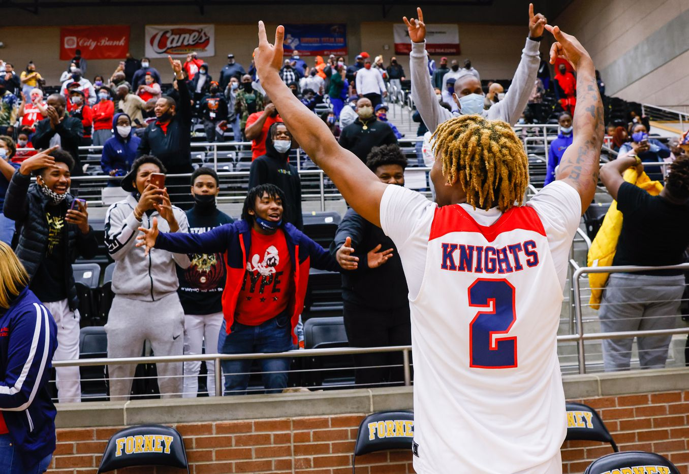 Kimball's Arterio Morris (2) celebrates his team's win over Lancaster during overtime of a boys basketball UIL Class 5A Region II playoff game in Forney on Friday, March 5, 2021. (Juan Figueroa/ The Dallas Morning News)