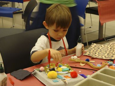 A child makes art at a summer camp hosted by the Dallas Museum of Art. The Irving Arts Center is hosting art camps virtually this summer over Zoom.