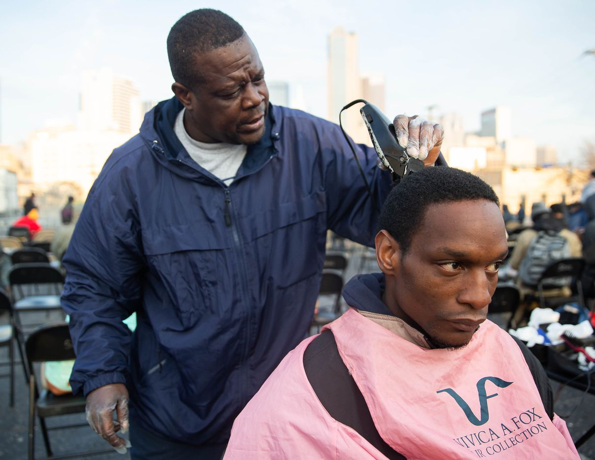 Isaac Bell (left) cut John Crawford's hair at S.O.U.L. Church on Dec. 8, 2019. Bell said he volunteered at the church because he loves the Lord.