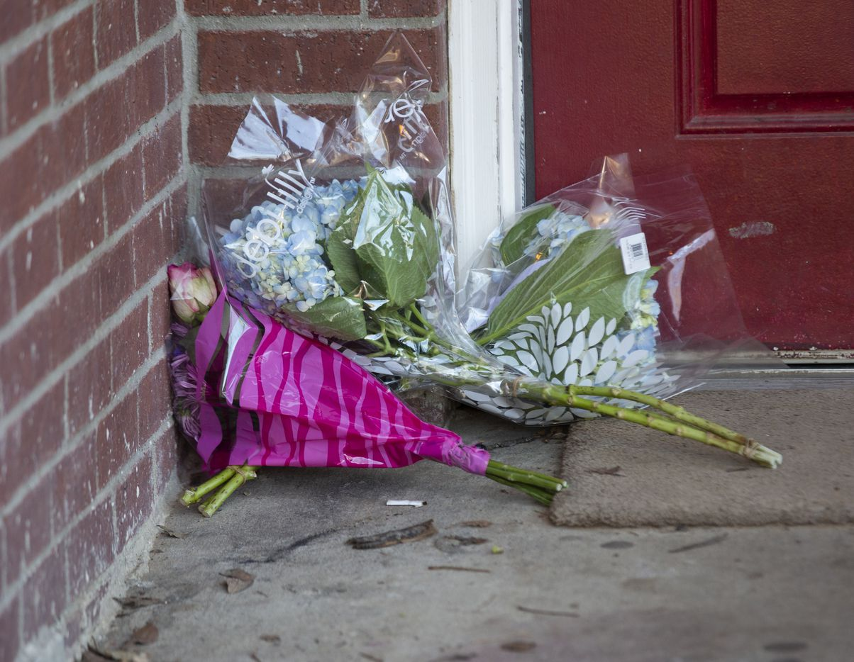 Well wishers left flowers at the Dallas home in the days after the shooting.