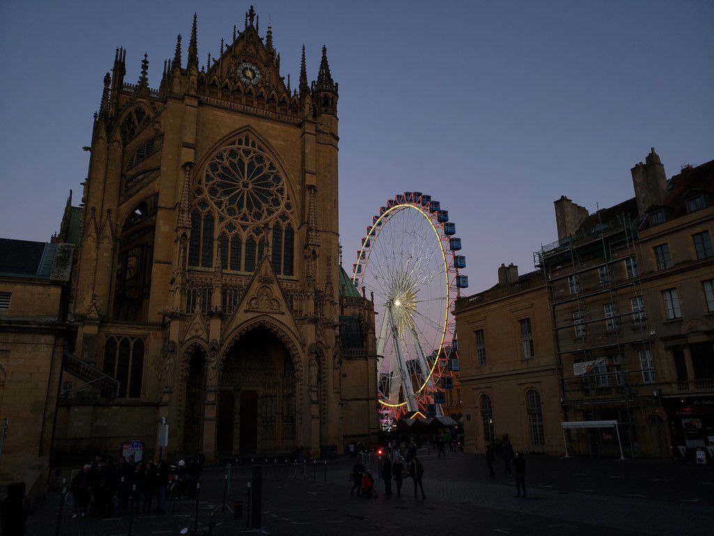 The Ferris wheel at the Christmas market in Metz, France, sits alongside the city's Gothic cathedral.