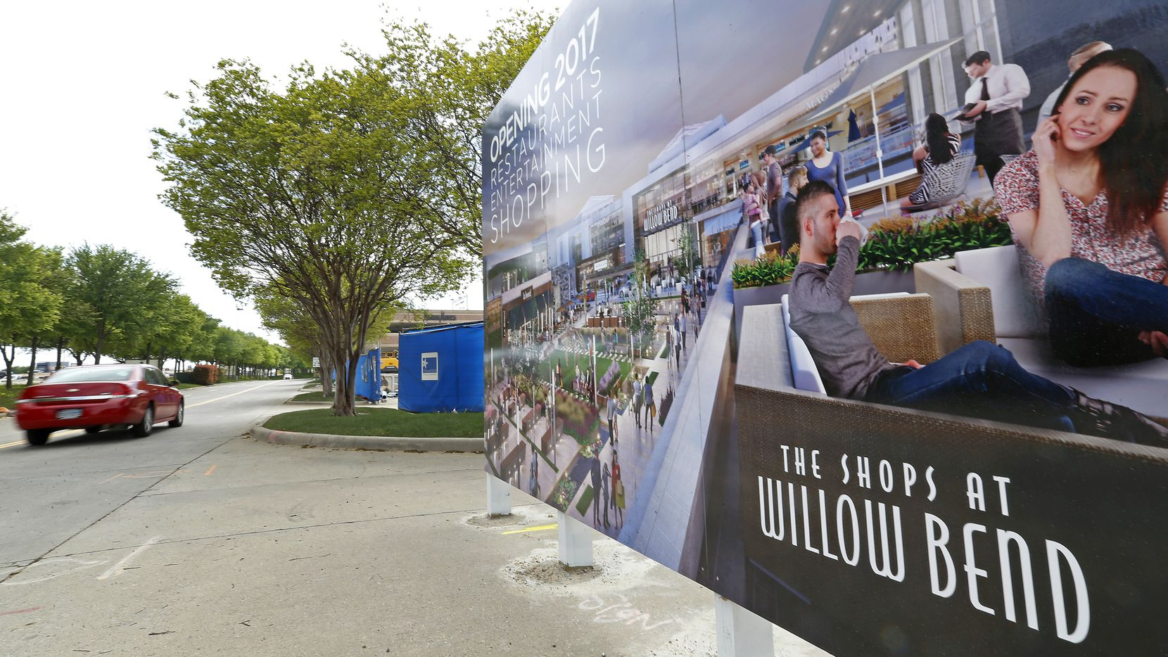 A car passes a rendering sign at the renovation project site of The Shops at Willow Bend in Plano.