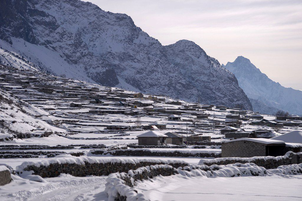 This photo, taken Jan. 29, shows a view of snow-covered homes in the Naltar Valley, some 15 miles north of Gilgit in Pakistan's remote mountainous north.  Bryan Harlan, a mortgage banking executive, paid $110,000 for a permit to kill a rare and endangered mountain goat in the northern Himalayan region of Gilgit-Baltistan.