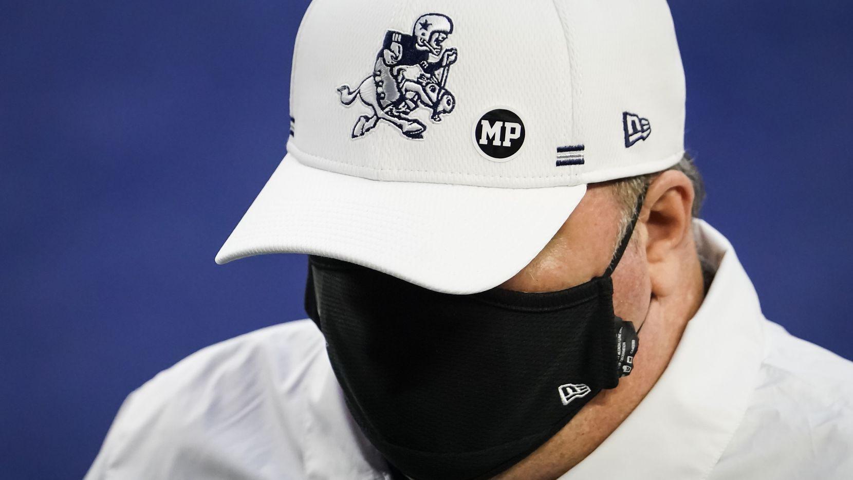 Dallas Cowboys head coach Mike McCarthy wears a sticker honoring strength and conditioning coach Markus Paul, who died Wednesday evening after having a medical emergency during Tuesday's practice, as he leaves the field for halftime of an NFL football game against the Washington Football Team at AT&T Stadium on Thursday, Nov. 26, 2020, in Arlington.