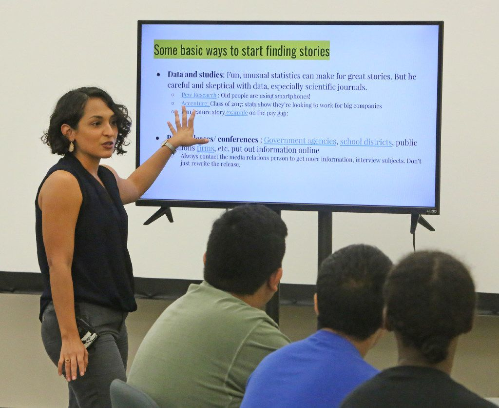 Dallas Morning News reporter Cassandra Jaramillo talks with Dallas high school students who have an interest in journalism and storytelling through the Storytellers Without Borders program conducted by The Dallas Morning News and the Dallas Public Library.