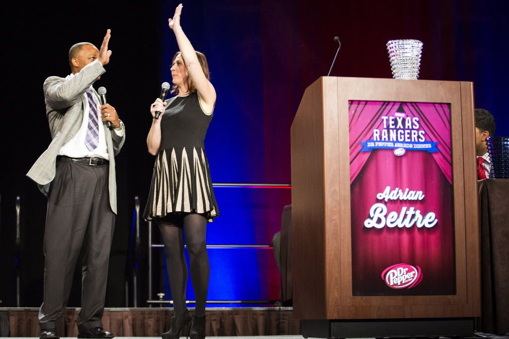 Texas Rangers third baseman Adrian Beltre high fives broadcast field reporter Emily Jones after he was presented the team player of the year award during the 2015 Dr Pepper Texas Rangers Awards Dinner at the Omni Dallas Hotel on Friday, Jan. 23, 2015, in Dallas. (Smiley N. Pool/The Dallas Morning News)
