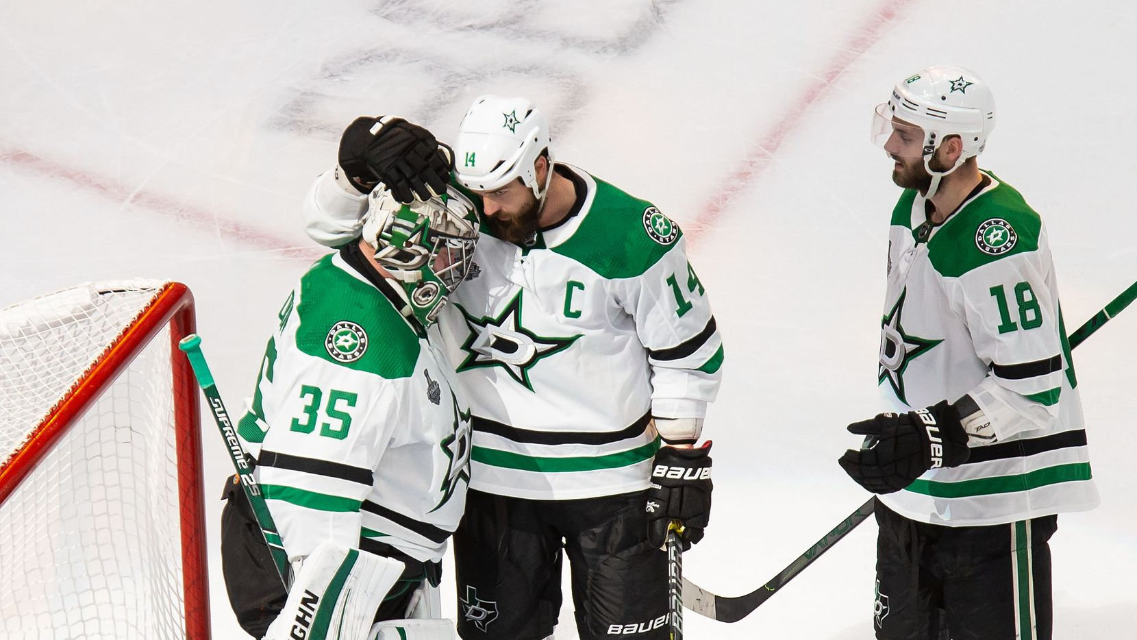 Goaltender Anton Khudobin (35), Jamie Benn (14) and Jason Dickinson (18) of the Dallas Stars celebrate their victory against the Tampa Bay Lightning during Game One of the Stanley Cup Final at Rogers Place in Edmonton, Alberta, Canada on Saturday, September 19, 2020. (Codie McLachlan/Special Contributor)