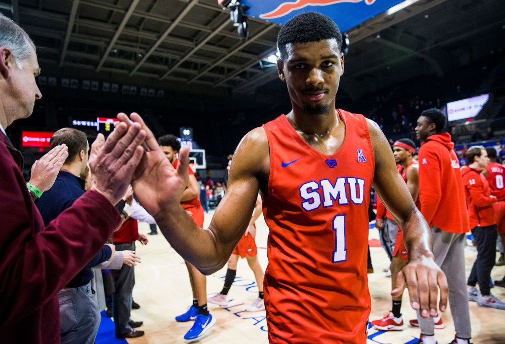 FILE - SMU forward Feron Hunt (1) gets high-fives after a game against UConn on Wednesday, Feb. 12, 2020, at Moody Coliseum on the SMU campus in Dallas.