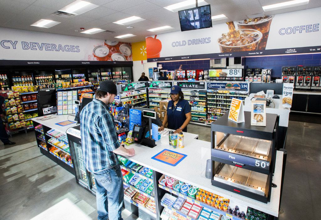Cashier Monica Betts helps a customer inside a new Walmart convenience store on Wednesday, February 8, 2017 on FM 1187 in Crowley, Texas. (Ashley Landis/The Dallas Morning News)