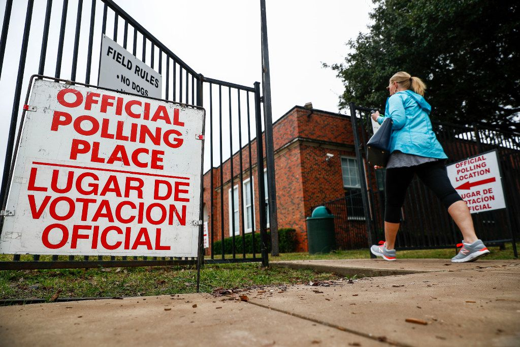 People arrive at a polling station at Robert S. Hyer Elementary to cast their ballot for the general election on Nov. 8, 2016, in Dallas. Almost every Dallas-area school district has postponed its May 2020 school board elections until November's general election.