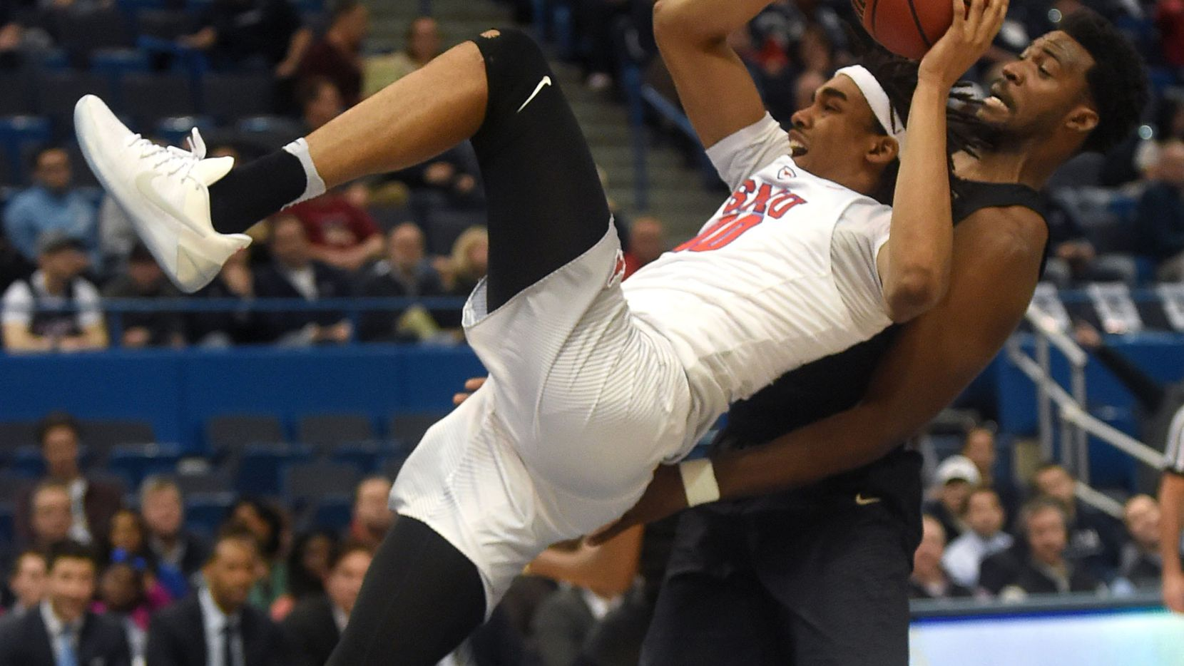 Southern Methodist's Ben Moore (00) tries to gather his feet in front of Central Florida's Chad Brown in the semifinals of the AAC Tournament at XL Center in Hartford, Conn., on Saturday, March 11, 2017. SMU advanced, 70-59. (Brad Horrigan/Hartford Courant/TNS)