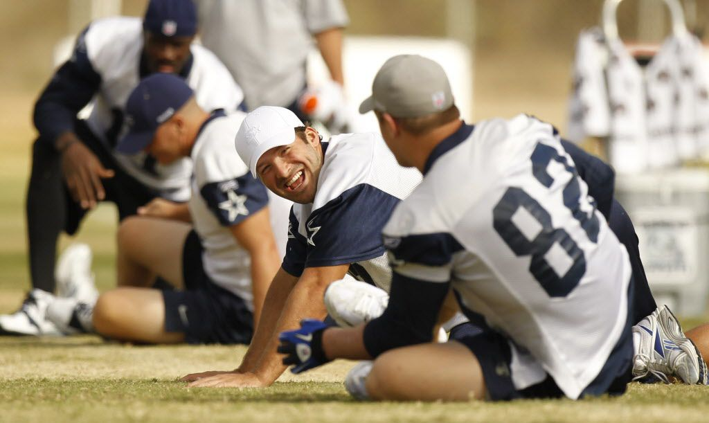 Dallas Cowboys quarterback Tony Romo (9) shares a laugh with Jason Witten (82) during morning practice at training camp in Oxnard, California, on August 26, 2010.  (Michael Ainsworth/The Dallas Morning News)