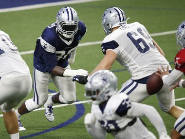 Cowboys defensive end DeMarcus Lawrence (90) rushes against Cowboys offensive tackle Brandon Knight (69) during training camp at The Star in Frisco on Monday, Aug. 17, 2020.