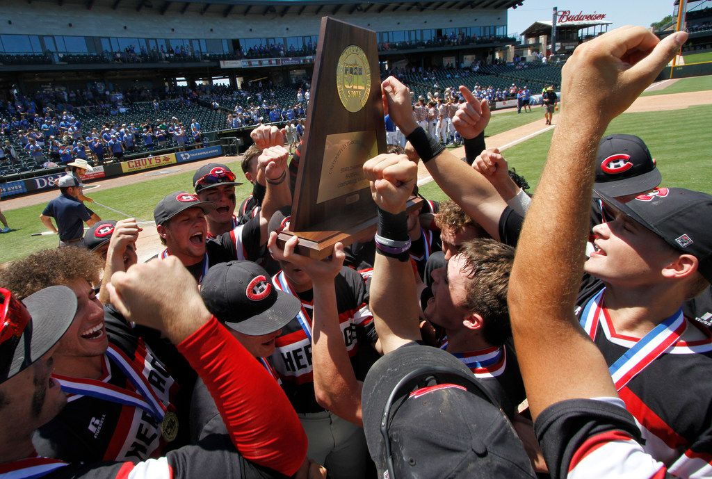Members of the Colleyville Heritage baseball team celebrate their 14-2 victory over Georgetown in 6 innings to claim Class 5A's top prize, the state championship trophy. The two teams played in the Class 5A state championship baseball game at Dell Diamond in Round Rock on June 8, 2019. (Steve Hamm/ Special Contributor)