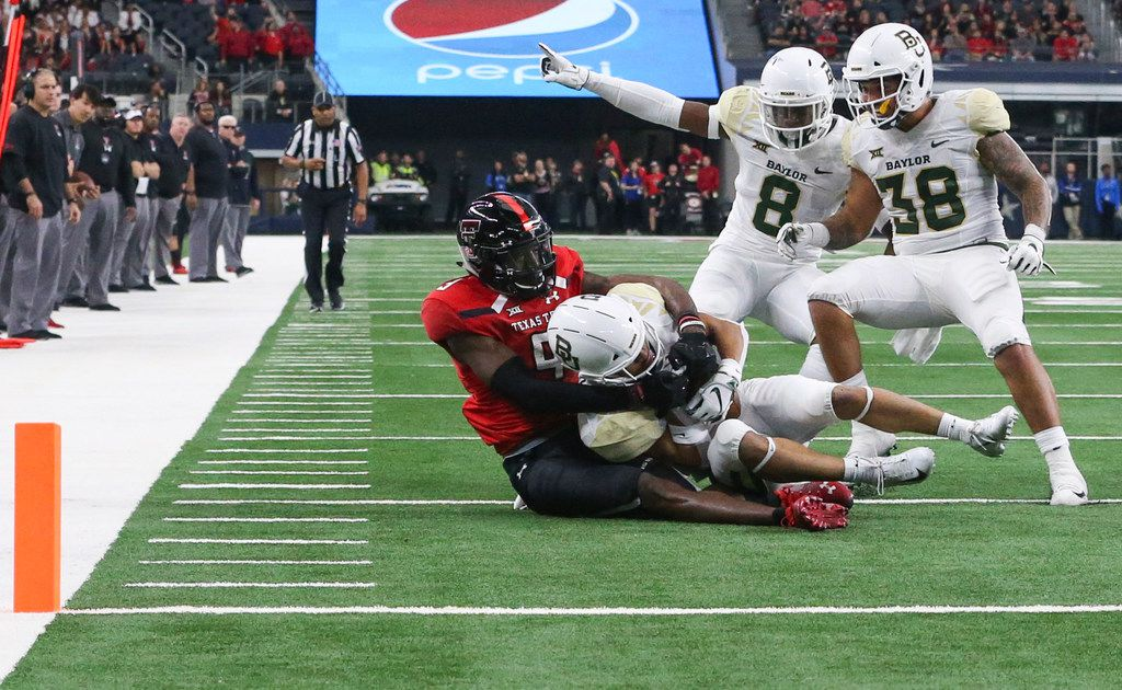 Baylor Bears cornerback Raleigh Texada (13) intercepts a pass intended for Texas Tech Red Raiders wide receiver T.J. Vasher (9) during a matchup between Baylor and Texas Tech on Saturday, Nov. 24, 2018 at AT&T Stadium in Arlington, Texas. (Ryan Michalesko/The Dallas Morning News)