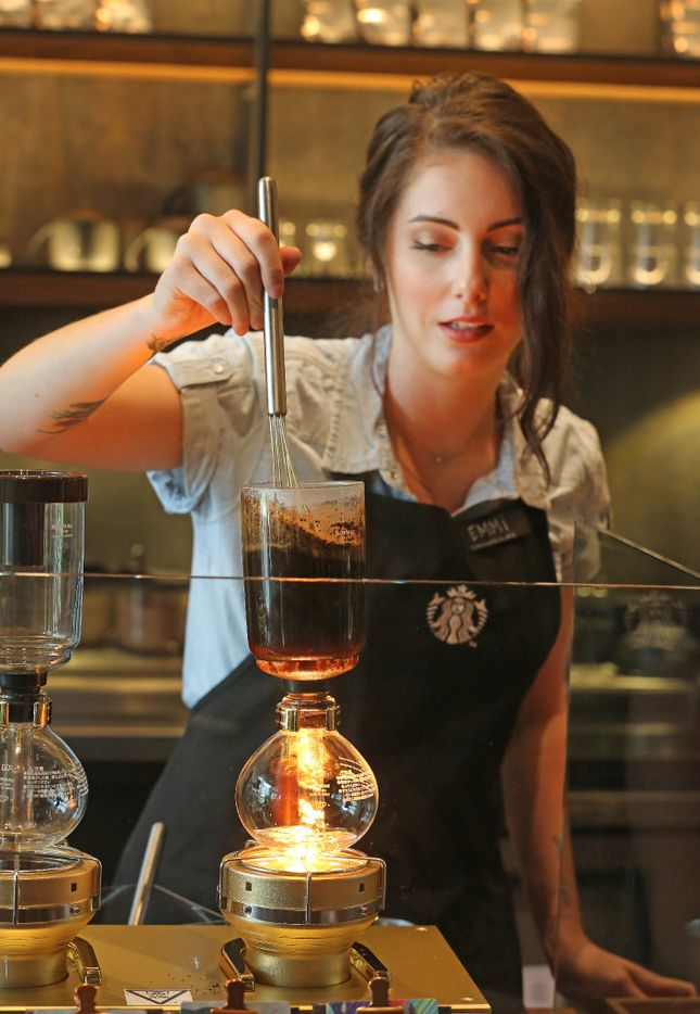 Emmi Lumkes brews coffee at the Starbucks Reserve bar at the McKinney & Olive high-rise in Dallas on opening day. Photos by Louis DeLuca/Staff Photographer