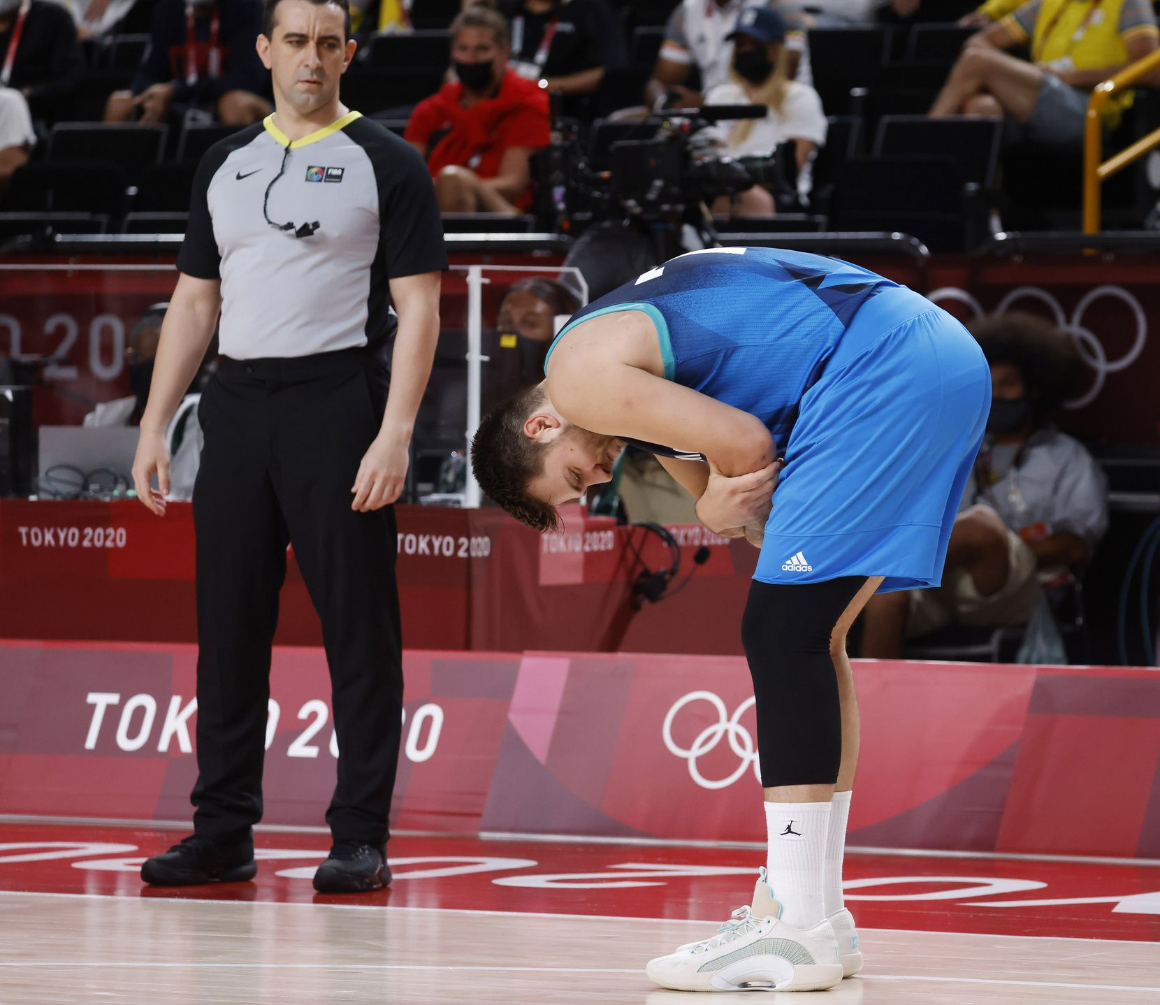 Slovenia's Luka Doncic (77) grabs his arm near his elbow where he fell on it during a game against France during the first half of a men's basketball semifinal at the postponed 2020 Tokyo Olympics at Saitama Super Arena, on Thursday, August 5, 2021, in Saitama, Japan. (Vernon Bryant/The Dallas Morning News)