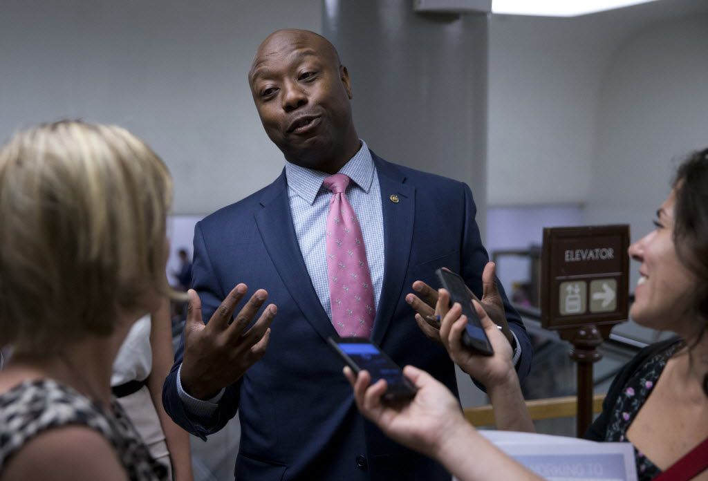 In this June 21, 2016, photo, Sen. Tim Scott, R-S.C., talks with reporters on Capitol Hill.