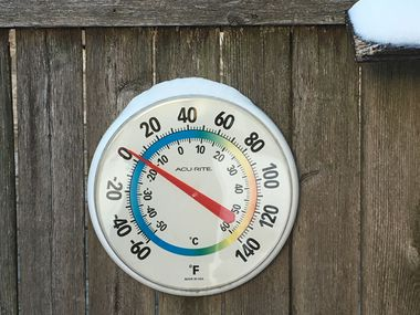 The outdoor temperature hovered close to zero degrees F on Tuesday morning, Feb. 16, 2021 in an East Dallas backyard, as unprecedented and dangrous freezing cold weather gripped North Texas.