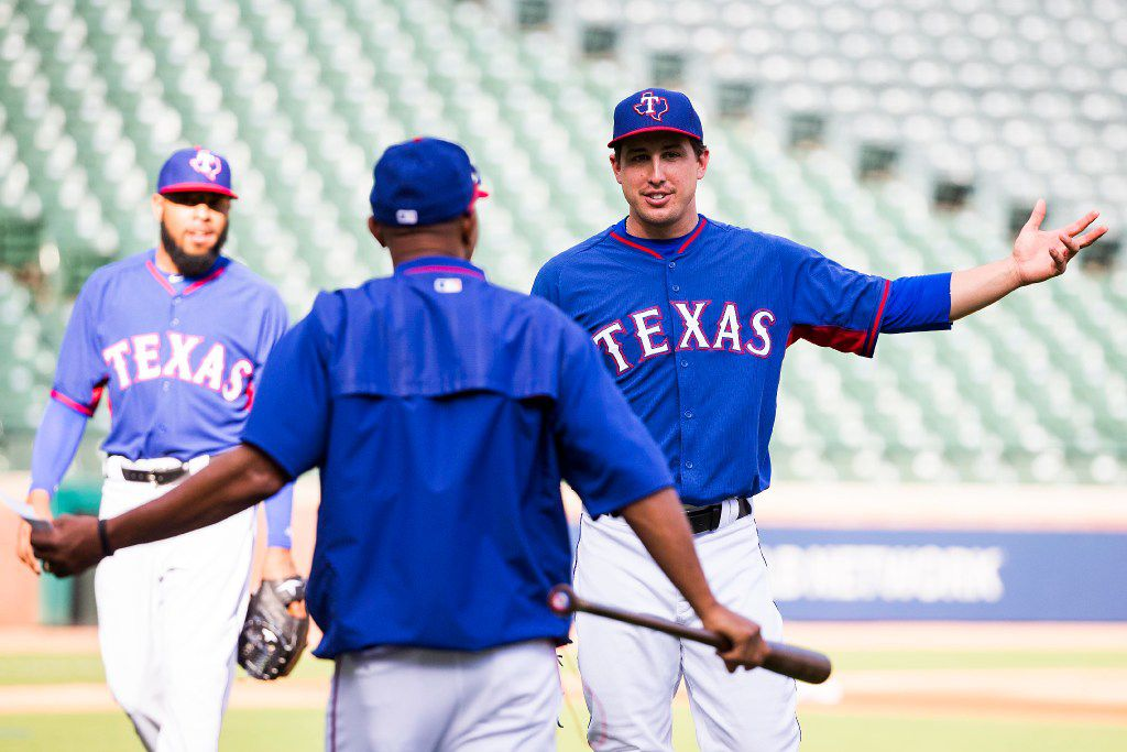 FILE - Rangers pitcher Derek Holland laughs with third base coach Tony Beasley during a team workout at Globe Life Park on Tuesday, Oct. 4, 2016, in Arlington. (Smiley N. Pool/The Dallas Morning News)