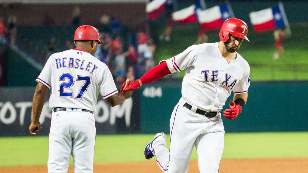 FILE — Texas Rangers OF Joey Gallo (13) shakes hands with third base coach Tony Beasley (27) as he rounds third base after hitting a home run during the fourth inning of an MLB game between the Texas Rangers and the Seattle Mariners on Tuesday, August 1, 2017 at Globe Life Park in Arlington, Texas.