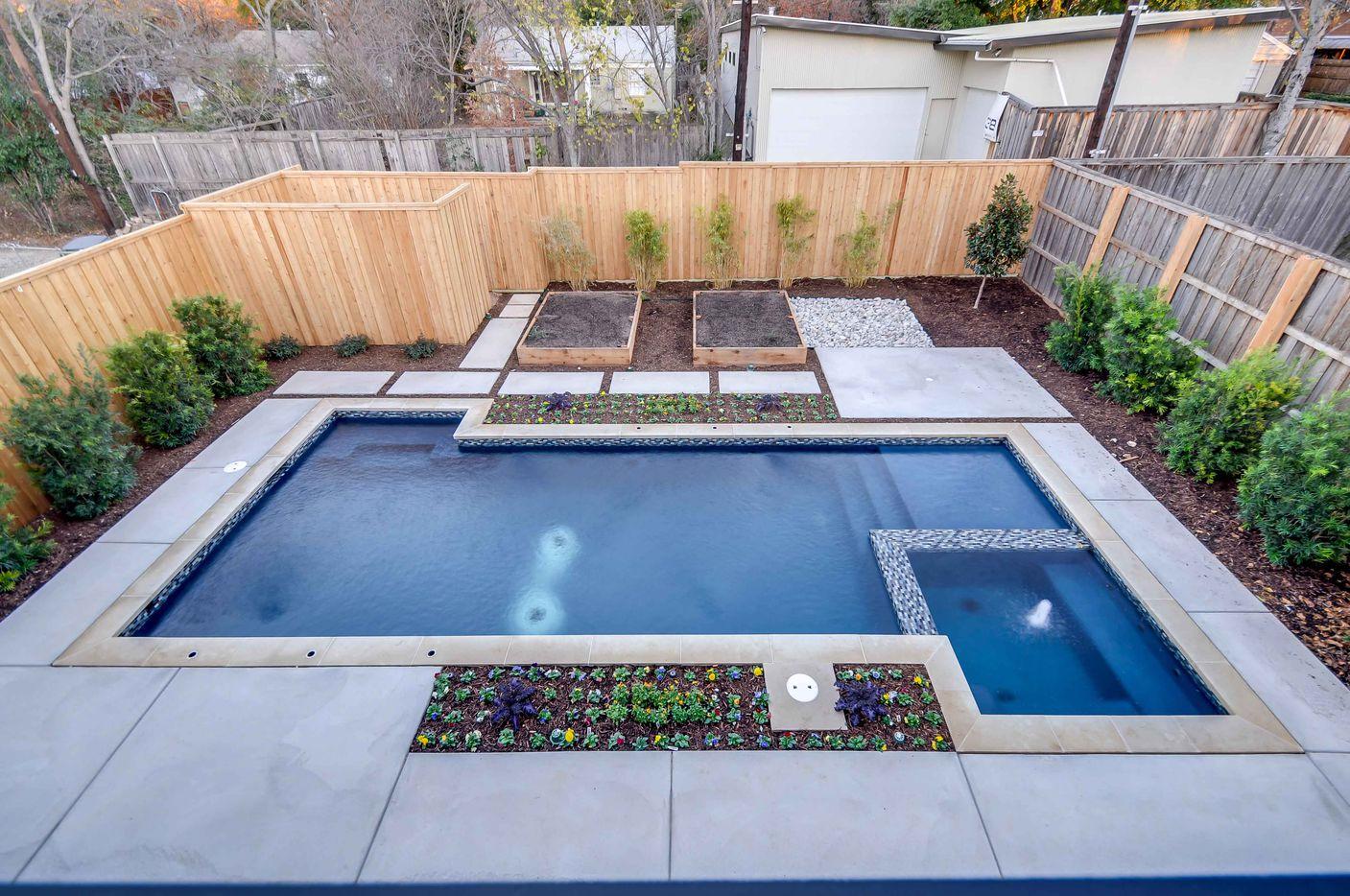 Classic Urban Homes Bluffview area house has a backyard pool.