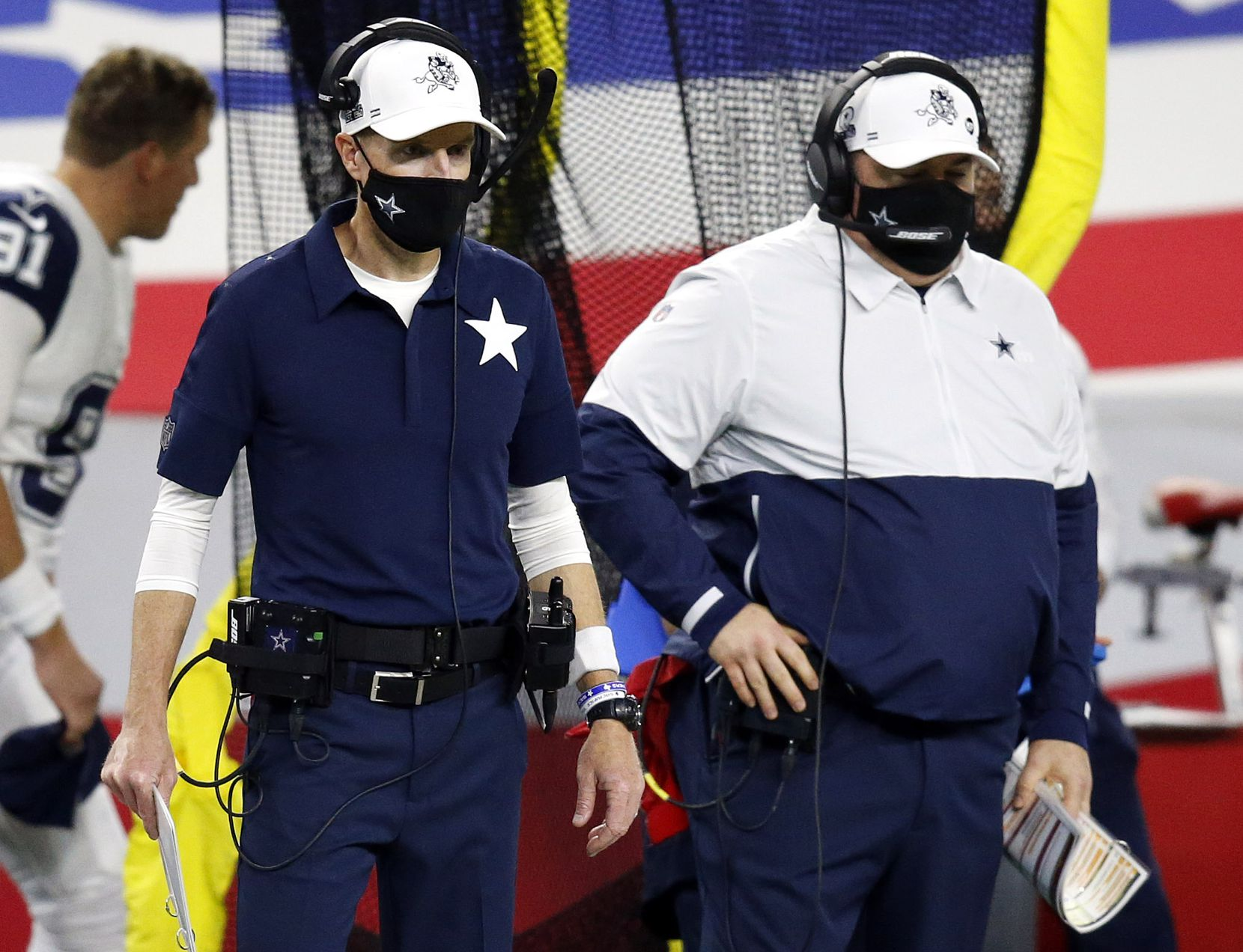 Dallas Cowboys special teams coordinator John Fassel (left) and head football coach Mike McCarthy watch their team play after they didn't convert a fourth down on a fake punt in the fourth quarter at AT&T Stadium in Arlington, Thursday, November 26, 2020. The Cowboys lost, 41-16. (Tom Fox/The Dallas Morning News)