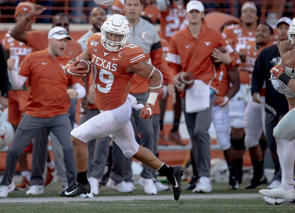 Texas defensive back Brandon Jones (19) returns a punt against Kansas State during the Longhorns' 27-24 win at Darrell K Royal-Texas Memorial Stadium on Saturday, Nov. 9, 2019, in Austin, Texas. (Nick Wagner/Austin American-Statesman via AP)