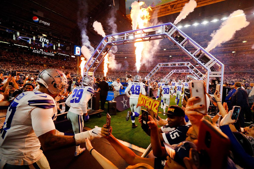 FILE - The Dallas Cowboys take the field for an NFC wild-card playoff game against the Seattle Seahawks on Saturday, Jan. 5, 2019, at AT&T Stadium in Arlington.