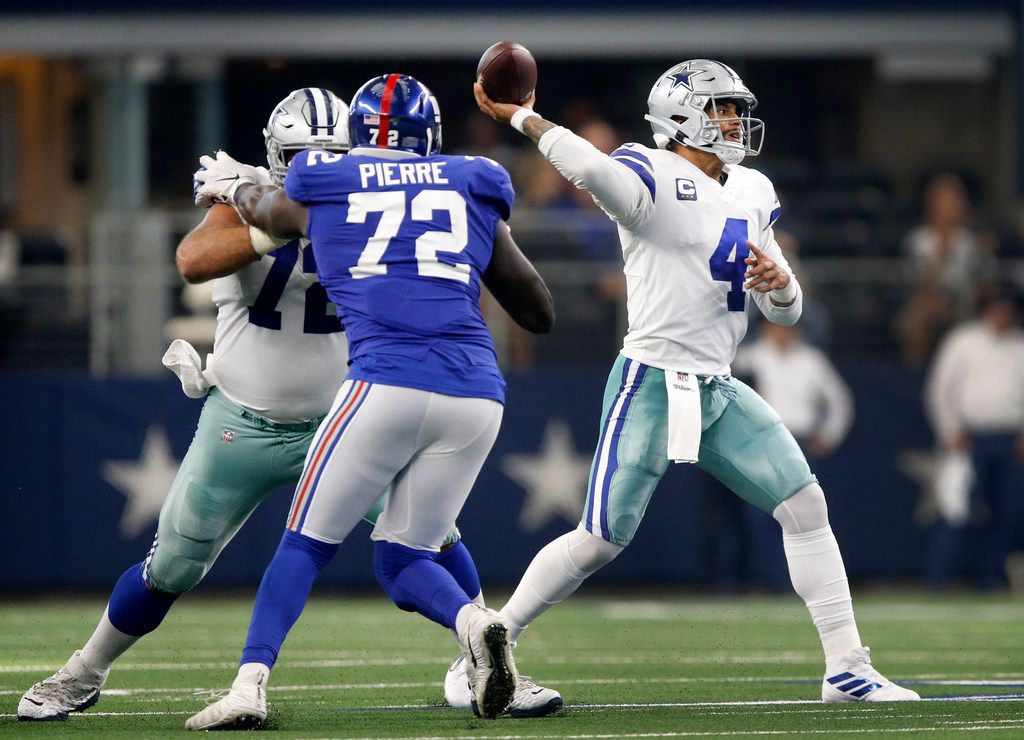 Dallas Cowboys quarterback Dak Prescott (4) throws a fourth quarter pass against the New York Giants during the third quarter at AT&T Stadium in Arlington, Texas, Sunday, September 8, 2019.