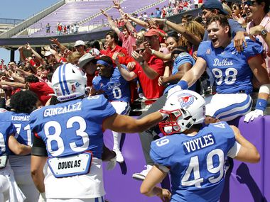 SMU Mustangs players celebrate with fans following their 42-34 victory over TCU. The two teams played their NCAA football game at Amon G. Carter Stadium on the campus of TCU in Fort Worth on September 25, 2021.