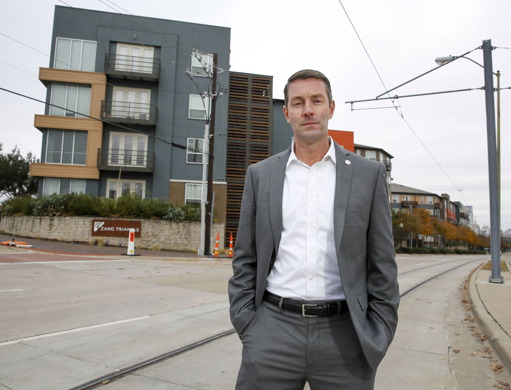 Dallas City Councilman Chad West standing on Zang Blvd. in the Oak Cliff neighborhood of Dallas Friday, November 22, 2019. West supported changing city policy to allow nonprofit developers of affordable housing to keep profits in order to build more.