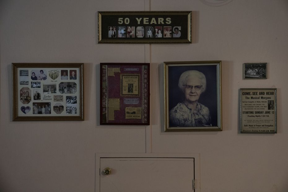 A wall inside the office of Border Missions, which was founded in 1956, displays photos of its co-founders, the Rev. Harold and Katherine Morgan.