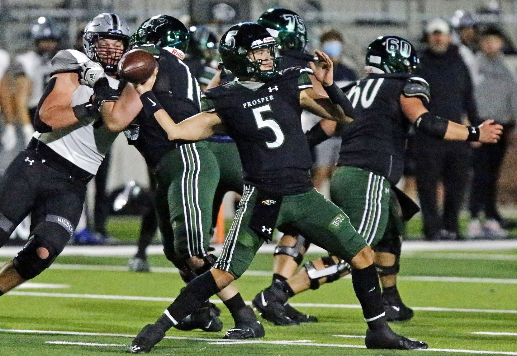 Prosper High School quarterback Jackson Berry (5) throws a pass during the first half as Prosper High School hosted Denton Guyer High School in a District 5-6A football game at Children's Health Stadium in Prosper on Friday night, October 30, 2020. (Stewart F. House/Special Contributor)