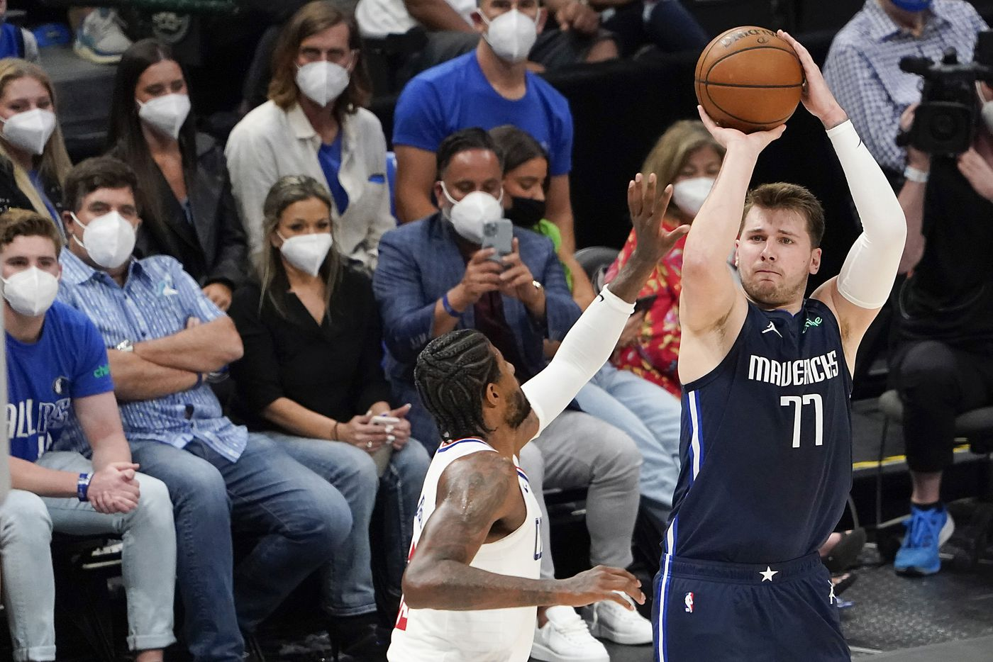 Dallas Mavericks guard Luka Doncic (77) shoots over LA Clippers guard Paul George (13) during the second quarter of an NBA playoff basketball game at American Airlines Center on Friday, May 28, 2021, in Dallas.