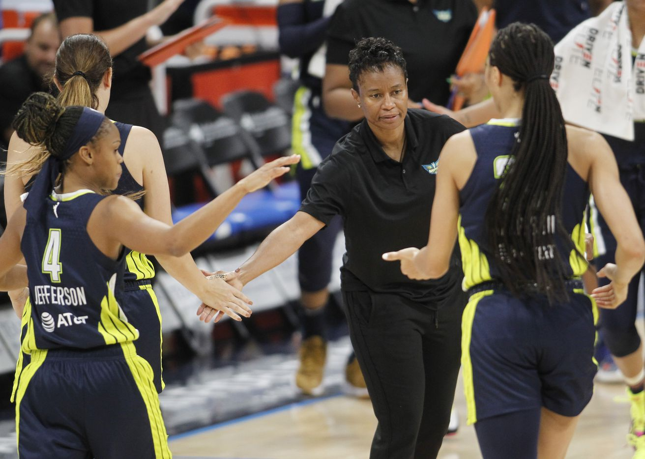 Dallas Wings head coach Vickie Johnson welcomes players to the team bench area for a first half timeout in their game against the Chicago Sky. Dallas lost to Chicago 91-81.The two WNBA teams played their game at College Park Center in Arlington on June 30, 2021. (Steve Hamm/ Special Contributor)