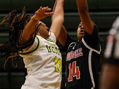 Duncanville's Kaila Kelley (14) attempts a shot as DeSoto's Jiya Perry (12) tries to block her during a basketball game in DeSoto on Saturday, Jan. 23, 2021.