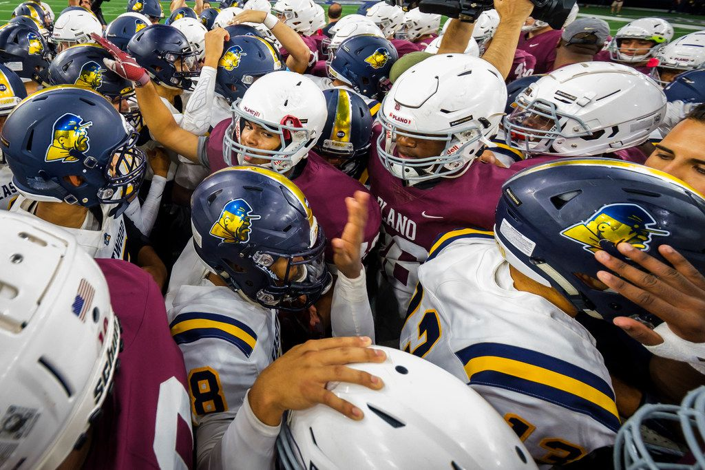 Players from Plano and El Paso Eastwood HIgh Schools meet at midfield before a high school football game at The Star on Thursday, Sept. 5, 2019, in Frisco, Texas. The game was originally canceled after a former Plano student allegedly killed 22 people in a shooting at an El Paso  Walmart. The game was reinstated after Plano ISD received pushback on its original decision.(Smiley N. Pool/The Dallas Morning News)