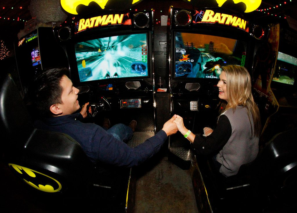"Just as Batman and Robin were coined the ""dynamic duo"", couple Ruben Ortega and Tori VanBuskirk enjoy a tandem video game while on a date at the Bishop Cidercade. (Steve Hamm/Special Contributor)"