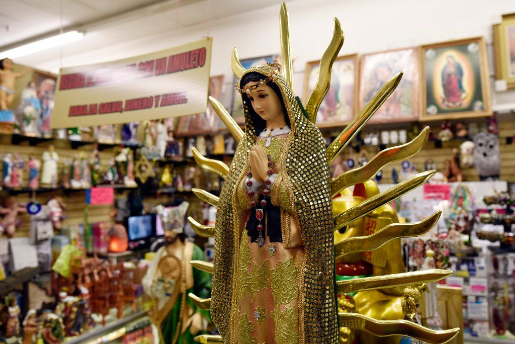 A Virgin of Guadalupe statue is among items for sale at Kathy's Botanica store inside the Garibaldi Bazaar in Dallas. (Ben Torres/Special Contributor)