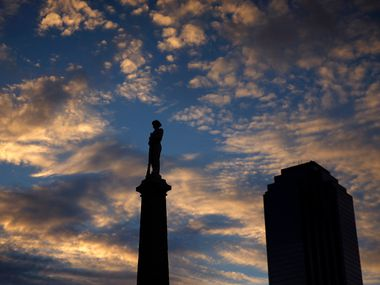 The Confederate War Memorial in Pioneer Park cemetery near the convention center and City Hall is seen at sunset in downtown Dallas.