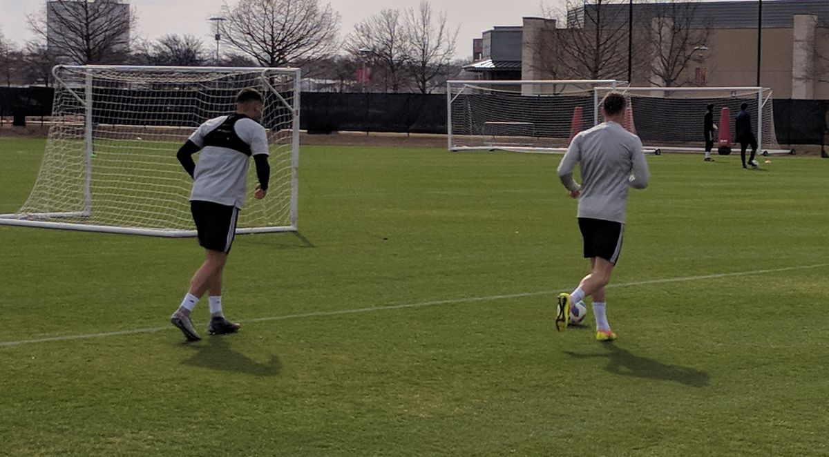 Jordan Cano (left) and Anton Nedyalkov (right) jog on the side of FC Dallas training. (3-8-18)