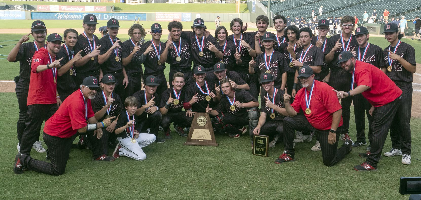 Rockwall-Heath gets a team photo taken with the UIL state trophy after defeating Keller in the 2021 UIL 6A state baseball final held, Saturday, June 12, 2021, in Round Rock, Texas.  Rockwall-Heath defeated Keller 4-3.   (Rodolfo Gonzalez/Special Contributor)