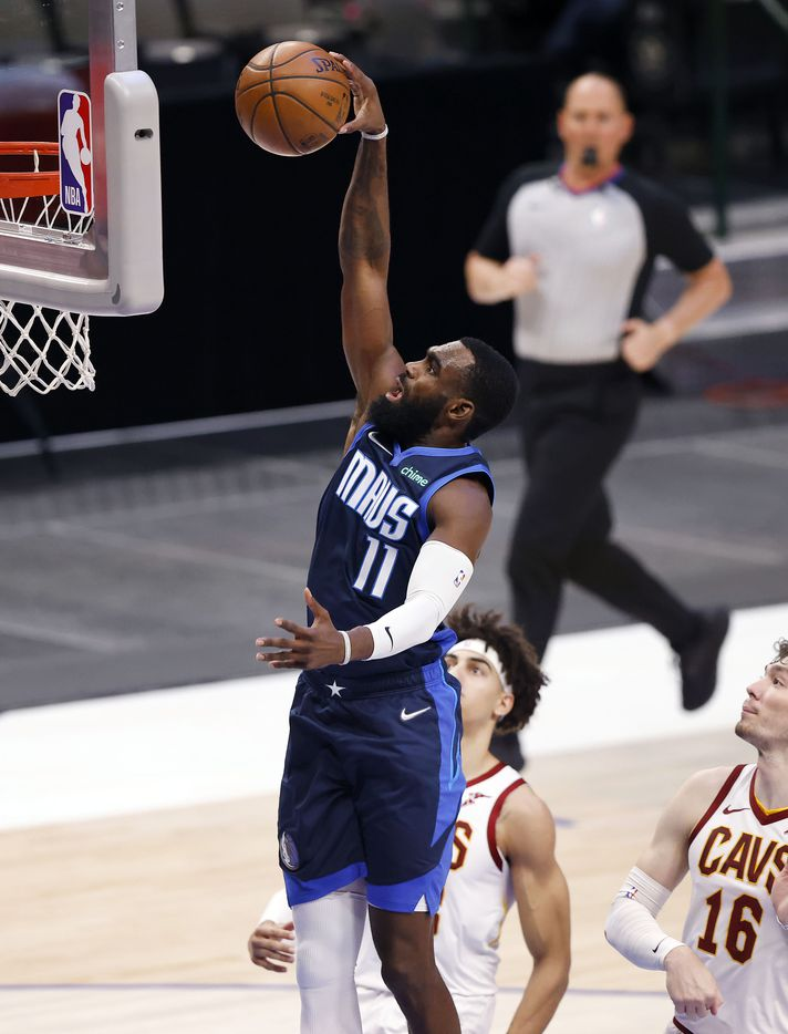 Dallas Mavericks forward Tim Hardaway Jr. (11) fleas to the basket for a first quarter dunk against the Cleveland Cavaliers at the American Airlines Center in Dallas, Friday, May 7, 2021. (Tom Fox/The Dallas Morning News)