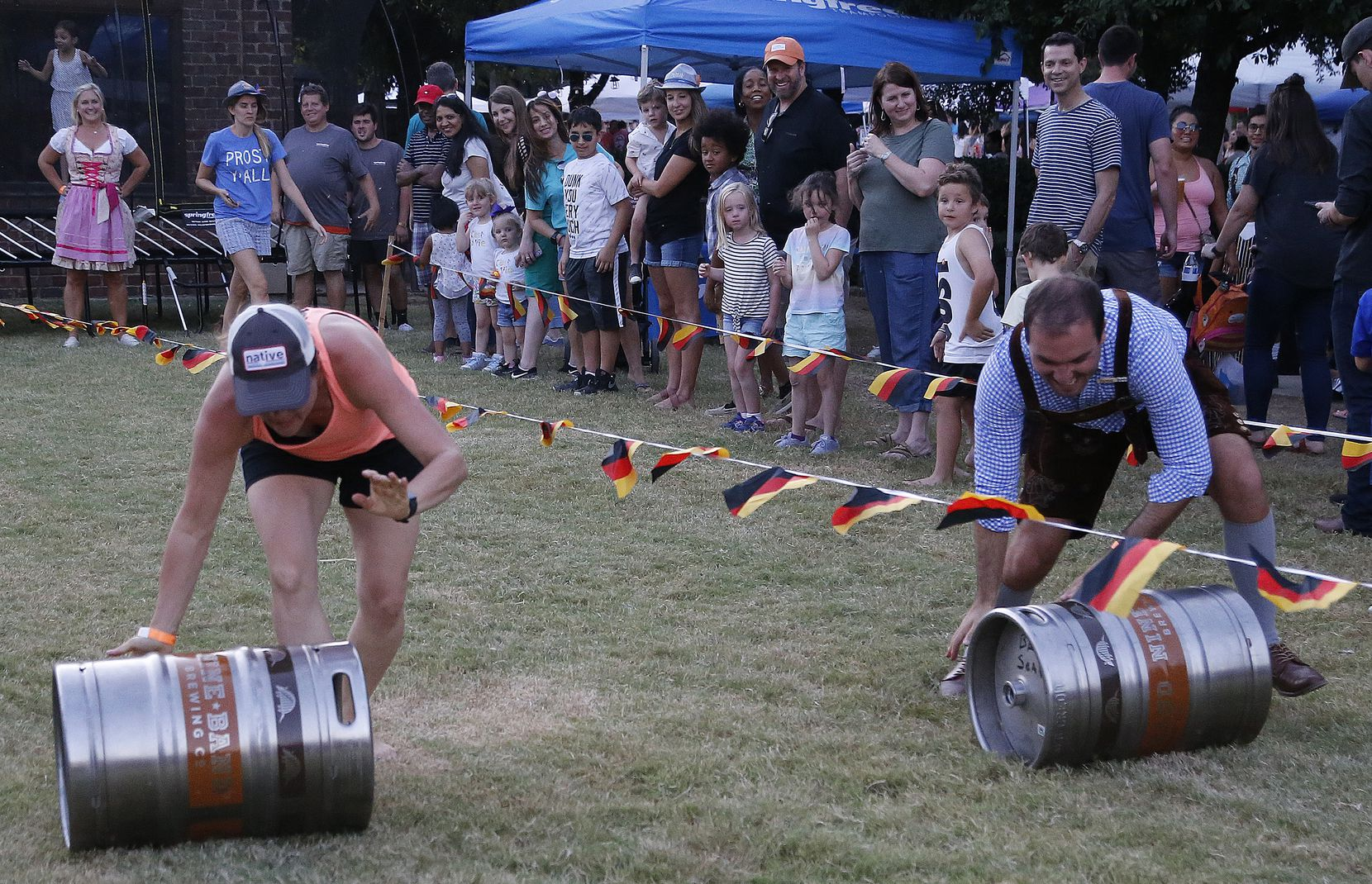 Wendi Ryan of Oak Point races a beer keg against Ryan Renke of Plano during the city of Frisco's 2019 Oktoberfest festival. The 2021 event is set for Oct. 2-3.