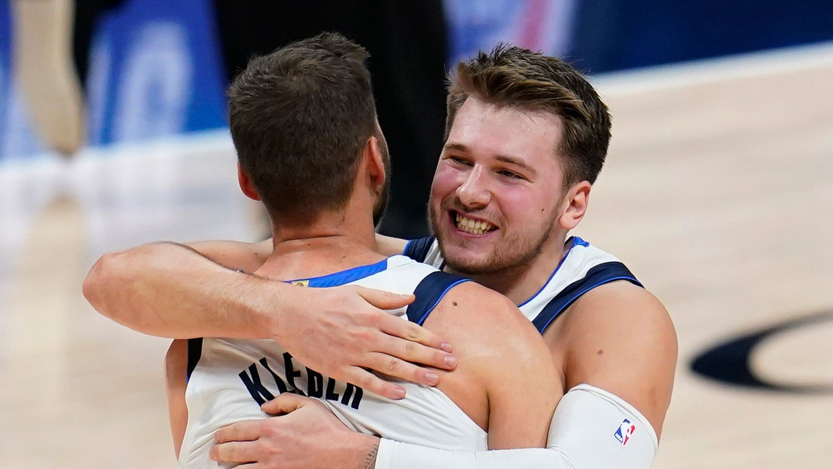 Mavericks guard Luka Doncic (77) hugs forward Maxi Kleber (42) after Kleber hit a basket late in the fourth quarter of a game against the Nuggets on Thursday, Jan. 7, 2021, in Denver. (AP Photo)